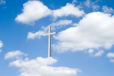 A beautiful partly cloudy blue sky  with religious cross resting on clouds for background Stock Photo
