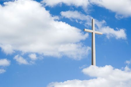 A beautiful partly cloudy blue sky with religious cross resting on clouds for background