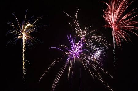 Multiple fireworks bursts in many colors photo