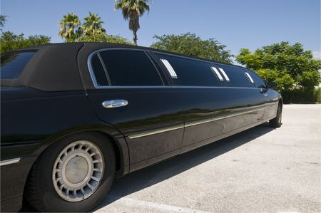 Black Stretch limousine waiting for guests to arrive Stok Fotoğraf