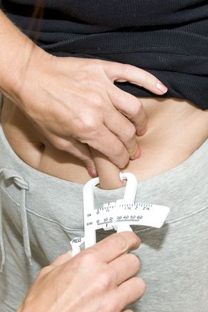 Measuring for Body Fat Content with Measuring Device Stock Photo