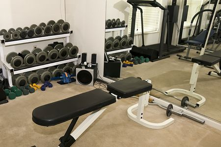 Typical Residential Weight and Exercise Room with a Mirror Wall Stock Photo
