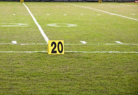 yardline: Twenty yard line marker on a football field
