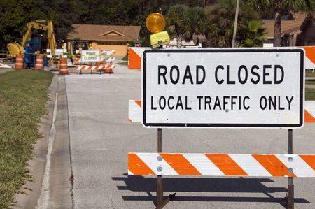 blockade: Road Closed signage due to construction ahead