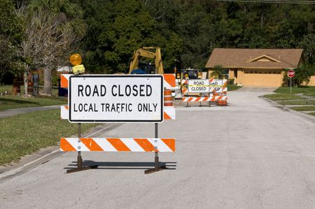 Road Closed signage due to construction ahead photo