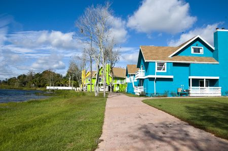 Brightly colored Abandon condominiums on a lake due to recession Stock Photo - 6112108