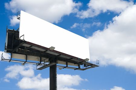 Blank double back to back billboard with partly cloudy sky