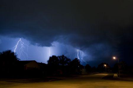 Simultaneous multiple lightning strikes in a neighborhood photo