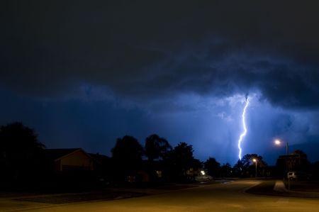 Lightning strike in a local neighborhood in a rain column Stock Photo - 7174515