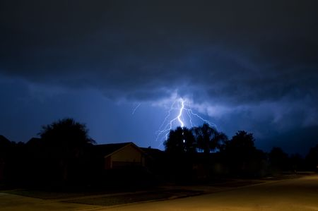 Lightning strike behind a tree in a local neighborhood Stock Photo - 7174509