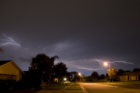 Spider cloud to cloud Lightning strike in a local neighborhood  Stock Photo