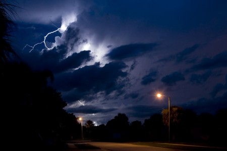 Massive bolt of lightning in a local neighborhood during a  swiftly moving storm Stock Photo - 7635188