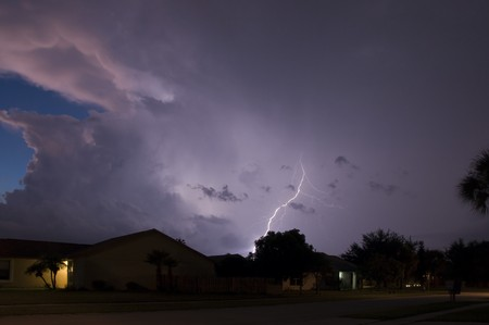 Lightning show in a local neighborhood just after sunset photo