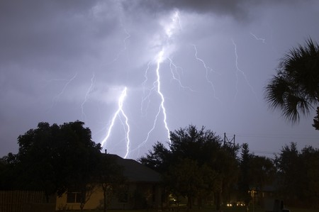 Extremely close lightning strike in a local neighborhood photo