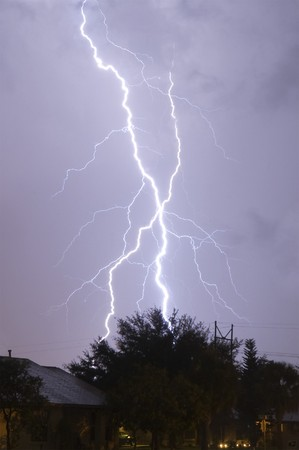 Extremely close lightning strike in a local neighborhood