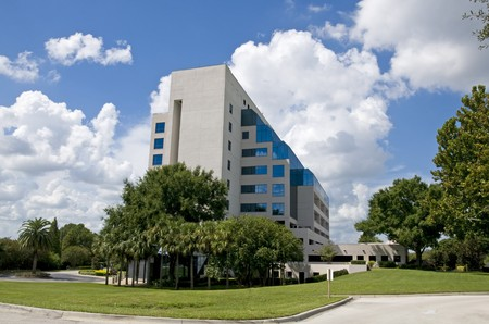 Modern corporate building well landscaped with partly cloudy blue sky Stock Photo - 7820072