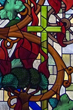 A stained glass window segment depicting the crucifix