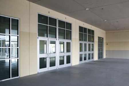 Multiple aluminum door entry area with glass windows