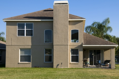Side of a modern two story home with blue sky Stock Photo - 9857244