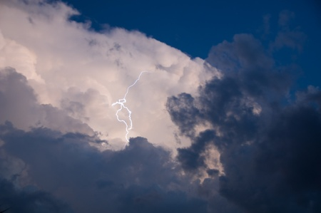 Lightning strike out of the clouds at sunset during a storm Stock Photo - 10739798