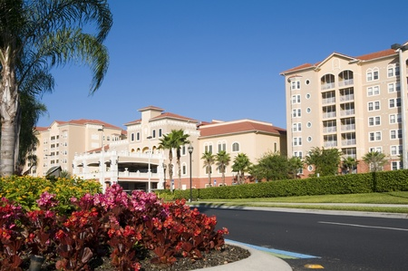 timeshare: A beautiful resort surrounded by palm trees and flowers with blue sky background