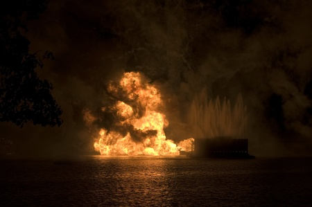 Gas fire explosion on water at night Stock fotó