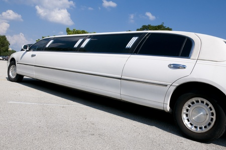 White Stretch limousine waiting for guests to arrive photo