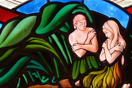 Stained Glass window segment of Adam and Eve in the Garden of Eden Editorial