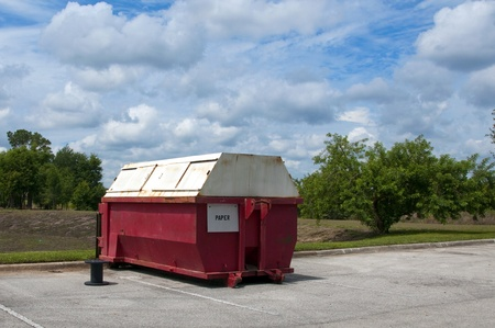 commercial recycling: Red Paper industrial recycling dumpster marked for paper only