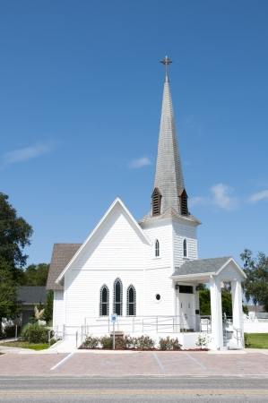 Very small rural christian church with a steeple Stock Photo
