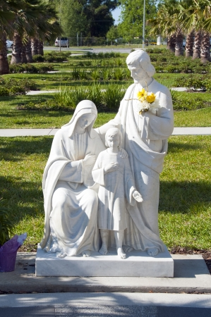 Marble statue of Jesus Mary and Joseph in a religious park
