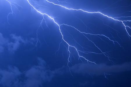 Blue lightning strike electrical storm after sundown in Florida