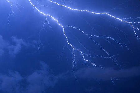 Blue lightning strike electrical storm after sundown in Florida