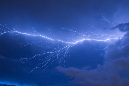 lightning storm: Telephoto of Blue lightning strike during an electrical storm in Florida Stock Photo