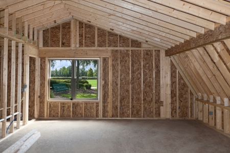 plywood: Room addition construction with pitched ceiling and garden view window
