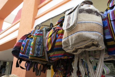 hand woven: Colorful Hand made Mexican handbags and totes for sell at an outdoor market in Cozumel Mexico