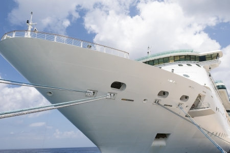 ship bow: The Bow of a passenger cruise ship showing multiple mooring lines