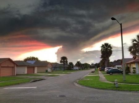 dark: Storm at sunset in a neighborhood scene Stock Photo