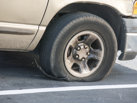 Tire failure exposing the steelbelt after a blowout