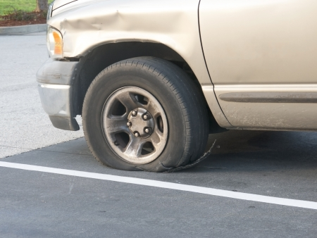 tire: Tire failure exposing the steelbelt after a blowout