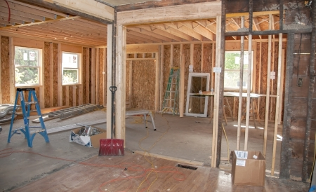 view of a wooden doorway: New construction addition being added to old home Editorial