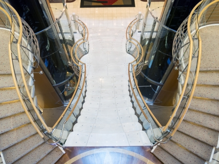 handrails: Double stone curved stairway from above with wooden handrails