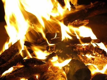 outdoor fireplace: Closeup of a log burning camp fire Stock Photo