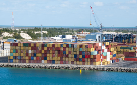 freeport: Port of Freeport Bahamas multi colored Container shipyard with deep blue ocean water Editorial
