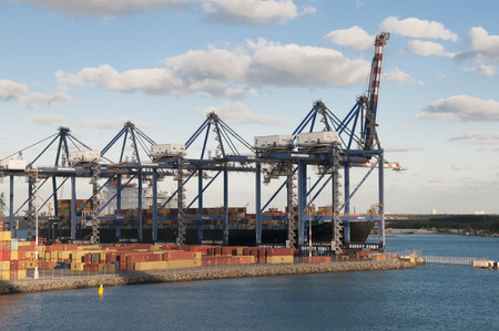 freeport: Port of Freeport Bahamas Container shipyard with heavy lifting Cranes and a ship waiting to off load its cargo