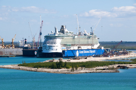 freeport: PORT OF FREEPORT GRAND BAHAMAS ISLAND - JAN., 18, 2015: Royal Carribeans Freedom Of The Seas in a floating drydock Editorial