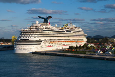 freeport: PORT OF FREEPORT GRAND BAHAMAS ISLAND - JAN., 18, 2015: Carnival Dream Cruise ship docked in Freeport Grand Bahamas at sunset