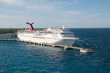 freeport: PORT OF FREEPORT GRAND BAHAMAS ISLAND - JAN., 18, 2015: Carnival Elation Cruise ship docked in Freeport Grand Bahamas at sunset