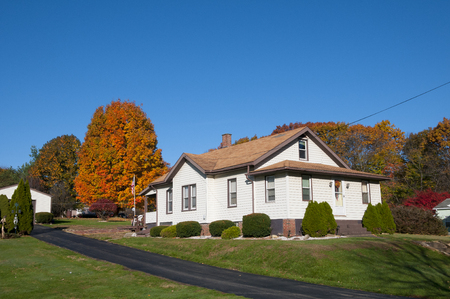 Single family dwelling on a hillside during the colorful fall season Stock Photo