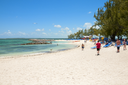 cay: COCO CAY, BAHAMAS - MAY 26, 2015: Sandy beach with people enjoying sun and fun on a sunny day Editorial